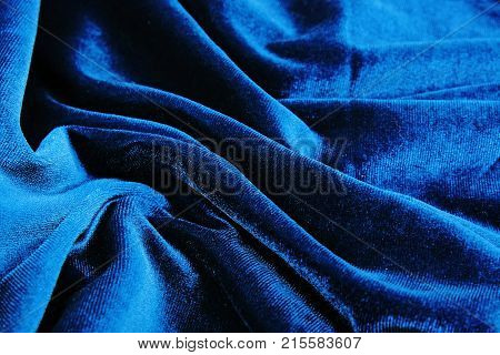 Silk dress material cloth texture pattern. Tailoring stitching concept. Shiny beautiful fashion fabric. Shiny clothing material sample.Creased fabric. Velvet blue. poster