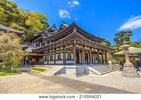 Kamakura, Japan - April 23, 2017: popular Buddhist temple and touristic attraction in Kamakura. Kannon-do or Main hall of Hase-dera Temple in Kanagawa Prefecture, in beautiful sunny day with blue sky.