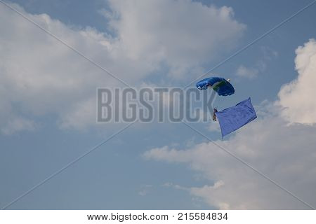 Paratrooper and drops and exposes the  flag
