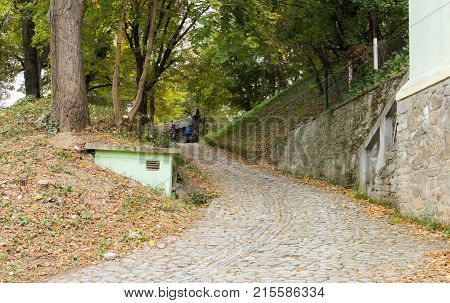 Sighisoara Romania October 08 2017 : Path leading from the cemetery to Church of the Deal (St. Nicholas) in the castle in Old City. Sighisoara city in Romania