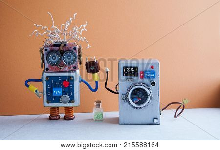 Washing machine laundry concept. Crazy robot handyman, brown light blue interior, blue floor. Funny toys creative design.