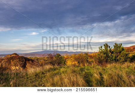 Countryside With Grassy Hills At Autumn Sunset