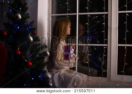 Dreaming Girl In Anticipation Of A Miracle On A Christmas