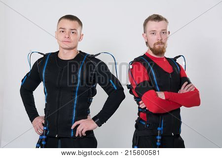 Two Men In An Electric Muscular Suit For Stimulation.