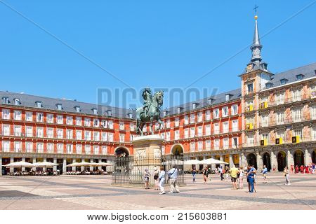 MADRID,SPAIN - AUGUST 5, 2017 : Tourists at Plaza Mayor, a historic square in Madrid