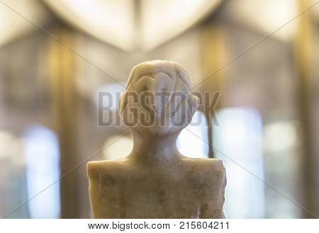 Badajoz Spain - January 29 2011: Anthropomorphous idol of Rena Badajoz. Representation of deity belong to Chalcolithic period at Archeological Museum of Badajoz