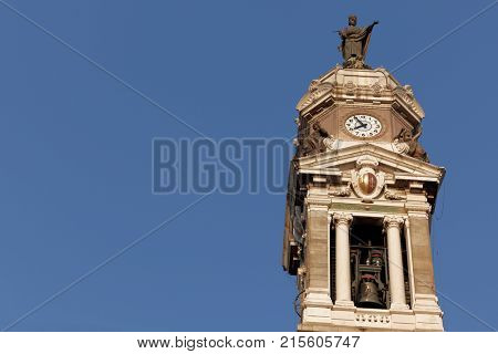 BERGAMO, ITALY - JUNE 11, 2017: Clock tower of Basilica di Sant'Alessandro in Colonna in a summer evening. The church was completed in XVIII century