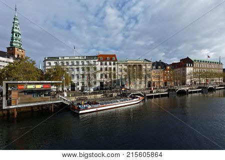COPENHAGEN, DENMARK - NOVEMBER 7, 2016: People in the tour boat at Ved Stranden street. Sightseeing tours is very popular among tourists