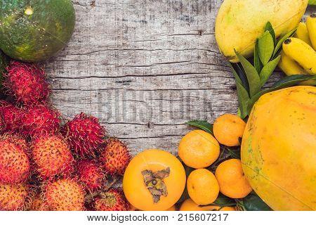 Colorful Fruits On The White Wooden Table, Bananas, Carambola, Mango, Papaya, Mandarin, Rambutan, Pa