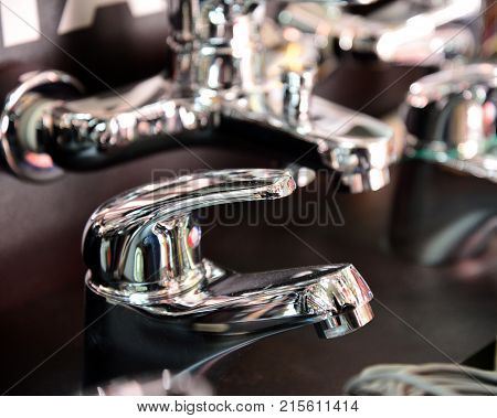 The Water Tap, Faucet For The Bathroom And Kitchen Mixer, In A Showroom, . Chrome-plated Metal.
