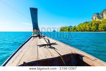 Closeup of longtail boat in sea at Aonang beach against blue sky
