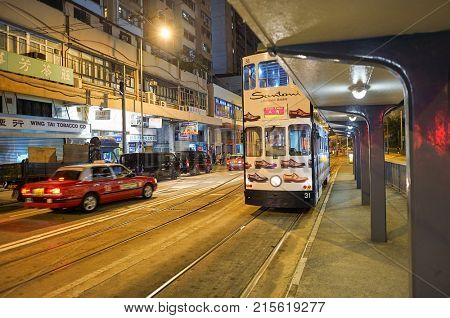 HONG KONG - DECEMBER 25, 2015: double-decker tramway at night. The tram is the cheapest mode of public transport on Hong Kong island