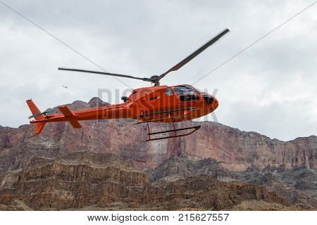 A helicopter soars through the air in the Grand Canyon