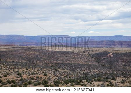 The desert stretches out in front of the Grand Canyon