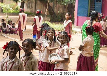 PONDICHERY PUDUCHERY INDIA - SEPTEMBER 04 2017. Unidentified boys girls children get in lines with their plates to clean it before lunch at the outdoor canteen.