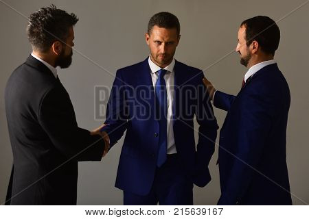 Business Agreement And Compromise Concept. Businessmen Wear Smart Suits