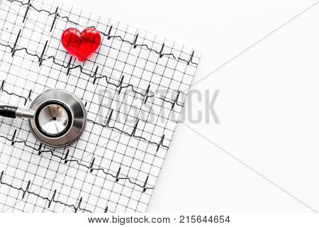 Examine the heart to prevent heart disease. Heart sign, cardiogram, stethoscope on white background top view.