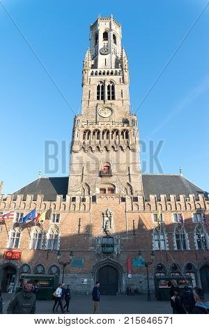 Bruges, Belgium - April 15, 2017: Ancient medieval tower with clock. The belfry of Bruges, or Belfort, is a medieval bell tower in the historical centre of Bruges.