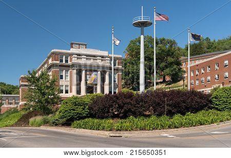 MORGANTOWN, WEST VIRGINIA - JUNE 12, 2016: Oglebay Hall and downtown buildings of campus of West Virginia University in Morgantown
