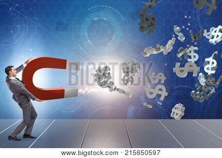 Businessman catching dollars on horseshoe magnet