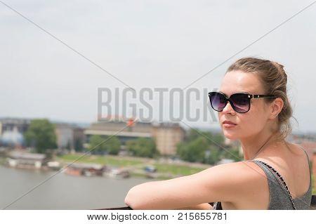 Girl In Sunglasses At Vistula River In Krakow, Poland