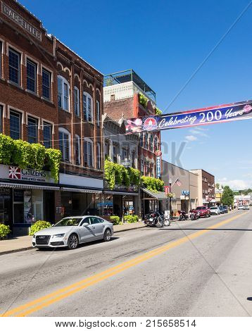 BUCHANNON, WEST VIRGINIA - AUGUST 13, 2016: Flags fly by bicentennial banner across Main Street in Buckhannon West Virginia