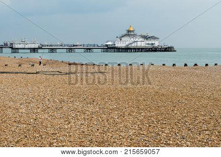 EASTBOURNE, UK - SEPTEMBER 19, 2016: View across the ocean to the pier and theatre at Eastbourne, UK