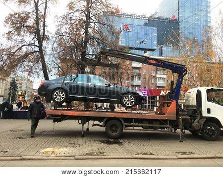 Voronezh, Russia - Circa November 2017: Evacuator takes an incorrectly parked car in downtown Voronezh, Russia