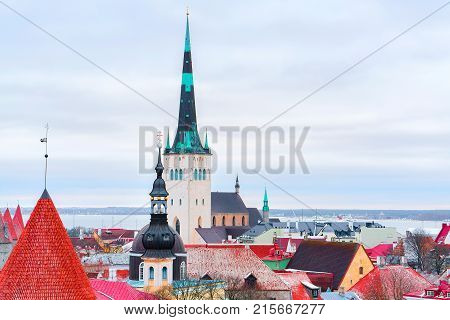 Cityscape with St Olaf Church and defensive walls of the Old town in Tallinn Estonia in winter. View from Toompea hill