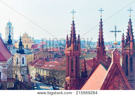 Steeples of Church of Saint Anne and cityscape in the Old city of Vilnius Lithuania.