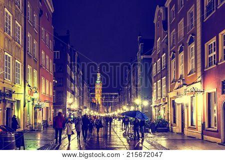 People Walk Along Long Street (dluga) In Gdansk, Poland