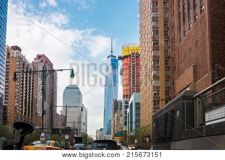 New York USA - May 5 2015: Street view of Road and Freedom Tower in Financial District in Lower Manhattan New York NYC USA