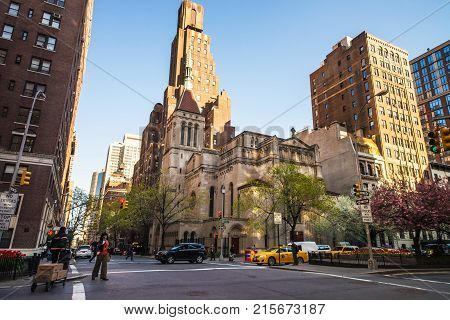 New York USA - April 24 2015: Street view of Church of Our Lady in Midtown Manhattan. Tourists in the street. Intersection of Park Avenue and 38th East Street NYC