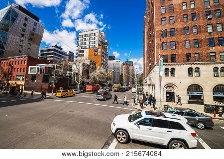 New York USA - April 24 2015: Intersection of 10th Avenue and West 23rd Street in Downtown Manhattan New York City NYC USA. Tourists in the street