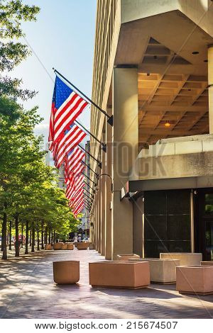 Washington DC USA - May 3 2015: Look at the entrance of the J. Edgar Hoover Building which is located in Washington D.C. US. It is the main building of the Federal Bureau of Investigation or FBI