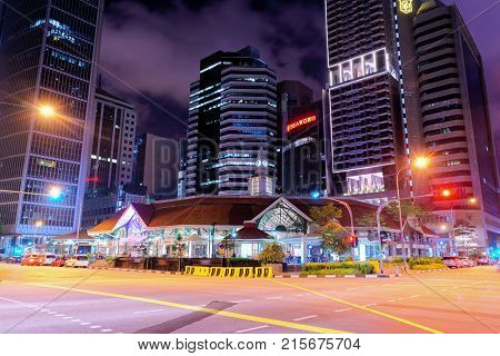 Singapore Singapore - February 29 2016: Telok Ayer Market and Singapore Stock Exchange building late in the evening in Singapore