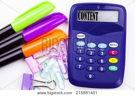 Writing Word Content Text In The Office With Surroundings Such As Marker, Pen Writing On Calculator.