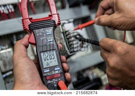 Electrical Engineer is check electrical equipment with a multi-meter