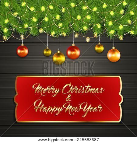 Christmas card with Cristmas fir tree branches on top, glowing garland and Christmas tree balls on black wooden board with greeting text Merry Chrismas and Happy New Year on red label with gold frame