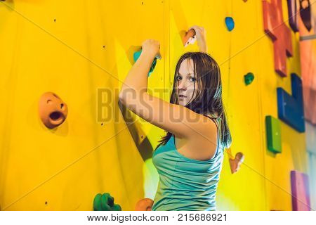 Attractive Young Professional Sport Climber Woman Having Training In The Gym At Artificial Wall