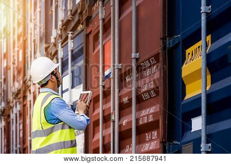 Foreman control loading Containers box from Cargo freight ship for import export foreman control Industrial Container Cargo freight ship