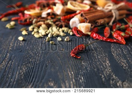 various colorful spices on dark wooden table