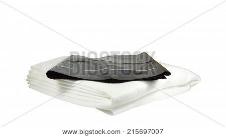 Accessories for watering indoor plants. Capillary mat made of synthetic felt of white color, absorbing and preserving water, and black protective fine-pored film. Isolated on white background