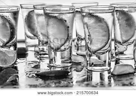 Black And White.closeup Vodka In A Glass With Ice, Lime Vodka, Gin, Tonic, Tequila. Close Up