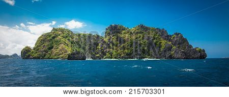 Scenic landscape with mountain islands and blue lagoon El Nido at Palawan. Philippines. Southeast Asia. Exotic scenery. Popular landmark famous destination of Philippines