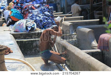 Mumbai India - October 12, 2017: Unidentified Worker Washes His Body In Dhobi Ghat Laundromat Mumbai