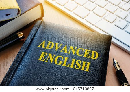 Book with title advanced english. Language learning concept.