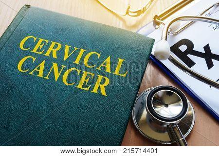 Book about cervical cancer on a desk.
