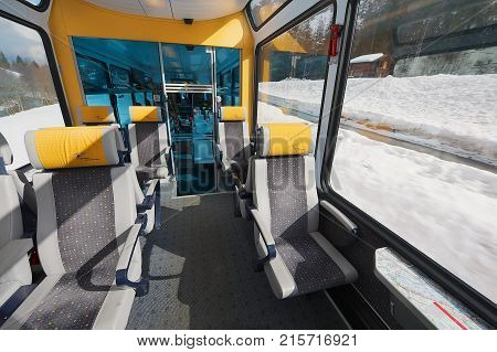 ZERMATT, SWITZERLAND - MARCH 03, 2009: Interior of the second class car in the train of Matterhorn Gotthard Bahn between Brig and Zermatt.
