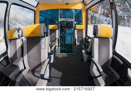 ZERMATT, SWITZERLAND - MARCH 03, 2009: Interior of the second class panoramic car in the train of Matterhorn Gotthard Bahn between Brig and Zermatt.